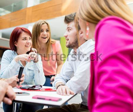 Image of young partners discussing brainstorming and ideas at me Stock photo © zurijeta