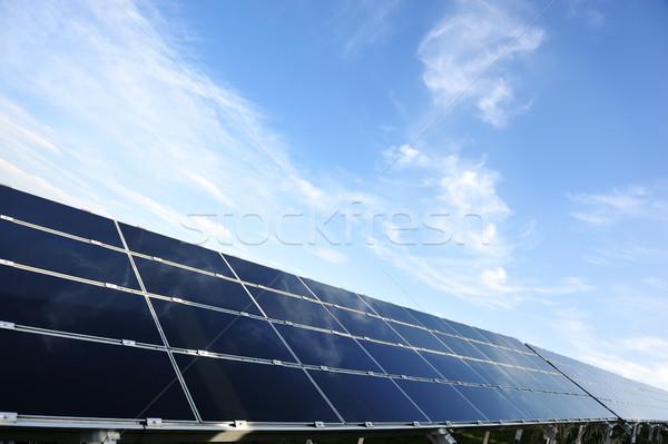 Fotovoltaikus napelemek copy space épület nap technológia Stock fotó © zurijeta