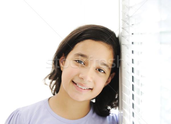 Boldog lány bent dől ablak boldog szemek Stock fotó © zurijeta
