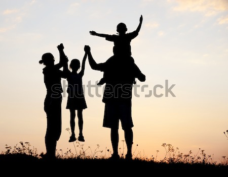Silhouette, happy children with mother and father, family at sunset, summertime Stock photo © zurijeta