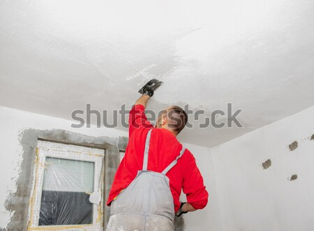 Stock photo: Construction workers painting walls