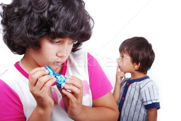 Girl is hiding a present from a boy Stock photo © zurijeta