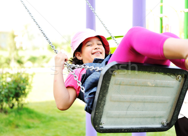 Little girl swinging in park Stock photo © zurijeta