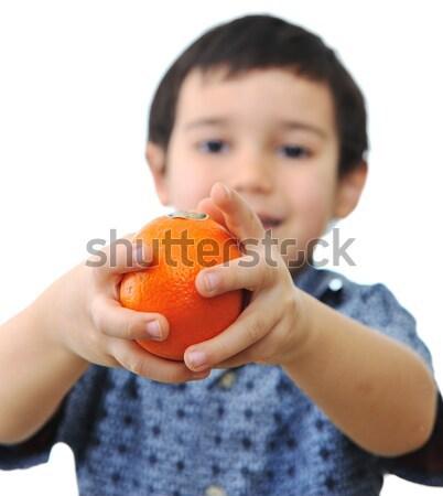 Little kid holding fresh oranges. Stock photo © zurijeta