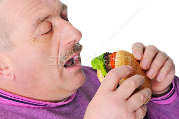 Stok fotoğraf: Yaşlı · adam · bıyık · yeme · Burger · moda · model