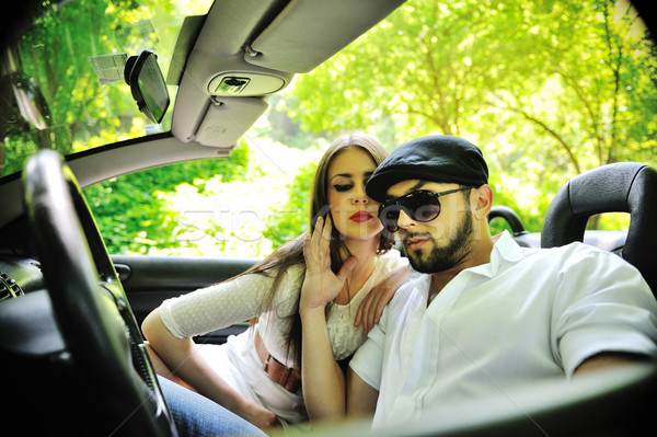Stock photo: Beautiful couple in a sports car outdoors