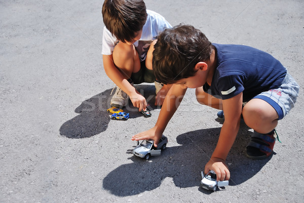 Toys cars in front of children legs Stock photo © zurijeta