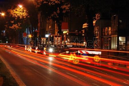 Colorful scene of traffic at night and workin area beside Stock photo © zurijeta