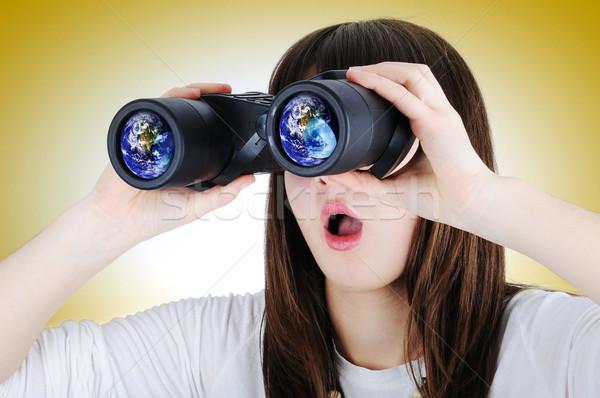 Girl with binoculars looking at the Earth Stock photo © zurijeta
