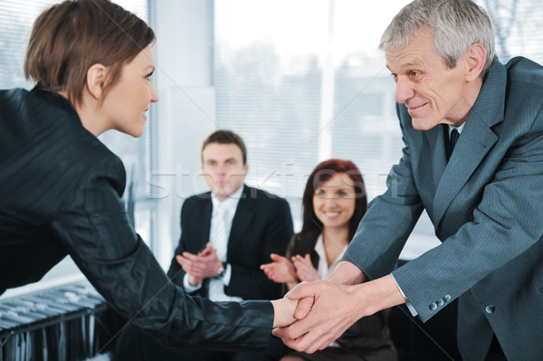Young business woman passed on a job interview shaking hands with boss Stock photo © zurijeta