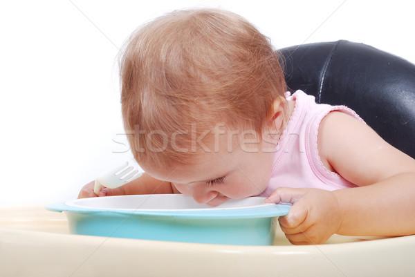 Baby sitting on the black chair eating Stock photo © zurijeta