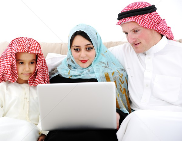 Arabic parents and little boy at home with laptop computer Stock photo © zurijeta
