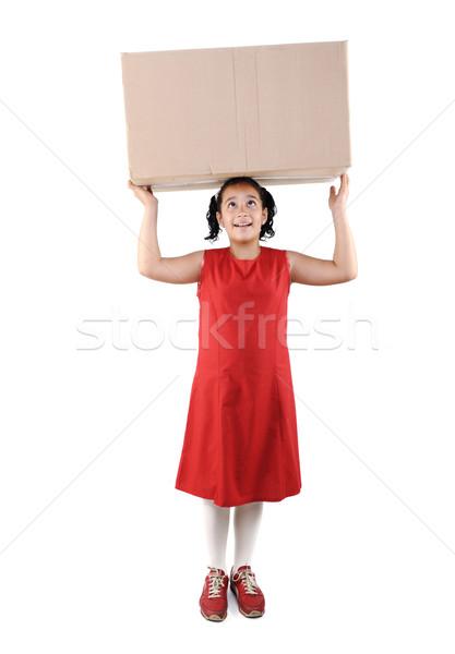 Little girl holding a box, isolated Stock photo © zurijeta