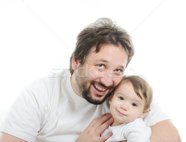 Happy young man holding a smiling 4-5 months old baby, isolated  Stock photo © zurijeta