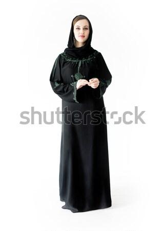 Arabic Muslim girl wearing black robe over white background posi Stock photo © zurijeta