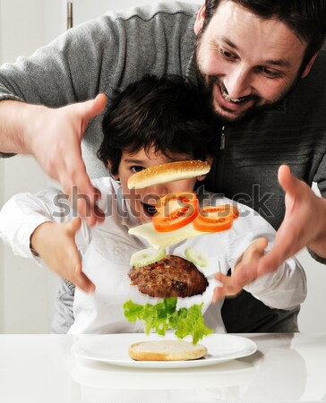 Levitating burger in air made by father and son Stock photo © zurijeta