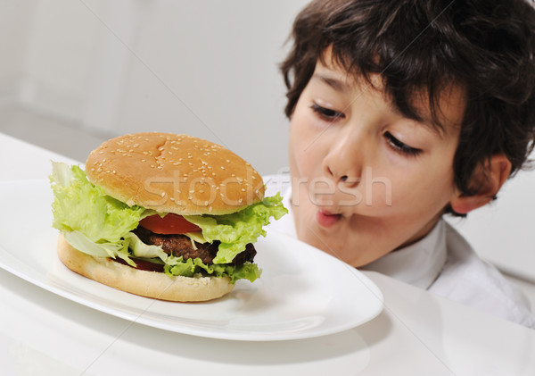 Kid on temptation with delicious hamburger Stock photo © zurijeta