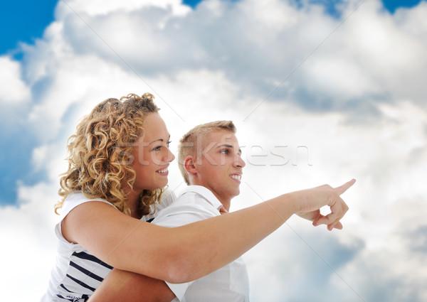 Portré tini pár háton együtt égbolt Stock fotó © zurijeta