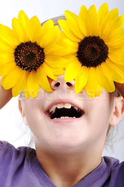 Foto d'archivio: Bambina · girasole · fiore · divertimento · ritratto · divertente
