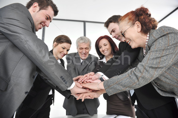 Group of business people with hands together for unity and partnership Stock photo © zurijeta