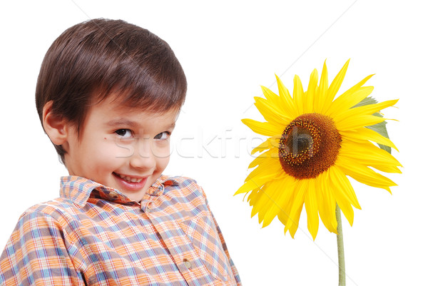 Very cute boy standing behind sunflower as friend Stock photo © zurijeta