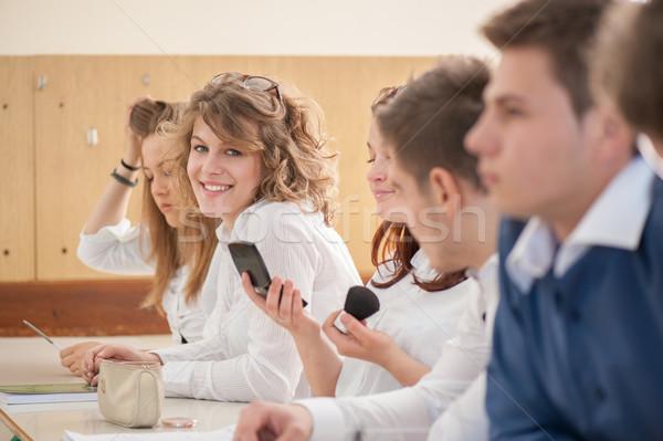 Mosolyog lány dől kollégák osztályterem oktatás Stock fotó © zurijeta