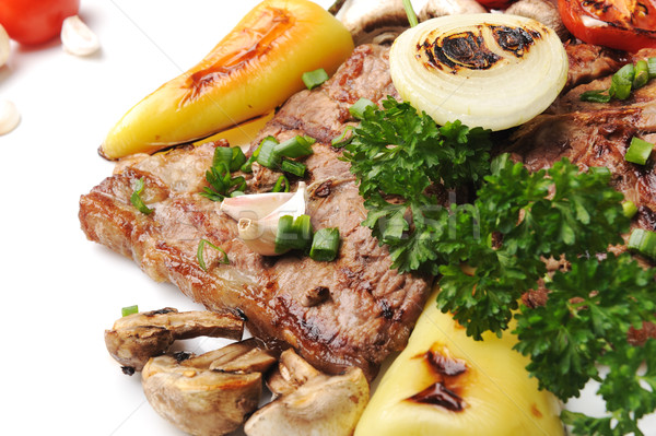 Grilled steak meat on a white plate on white isolated background Stock photo © zurijeta