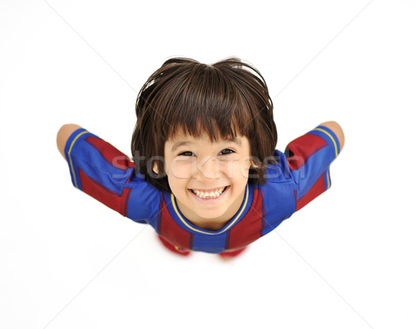Happy child, positive fresh little smiling boy from above, different angle, isolated on white, full  Stock photo © zurijeta