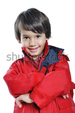 Kid with red jacket on white background Stock photo © zurijeta