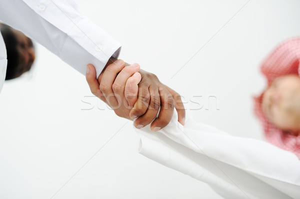 Closeup of business people shaking hands over a deal Stock photo © zurijeta