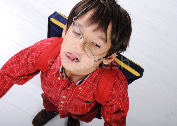 Iskolás fiú hátizsák mosoly divat diák szemüveg Stock fotó © zurijeta