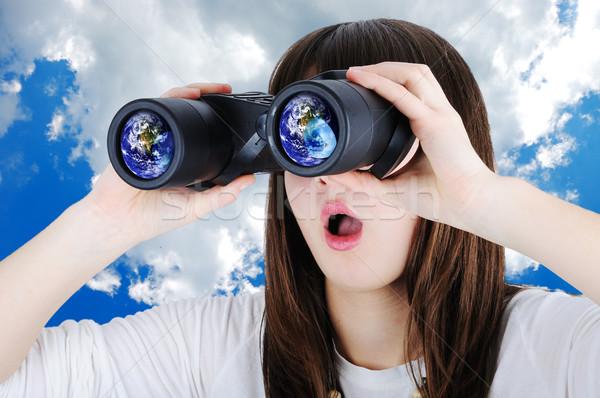 Girl with binoculars Stock photo © zurijeta