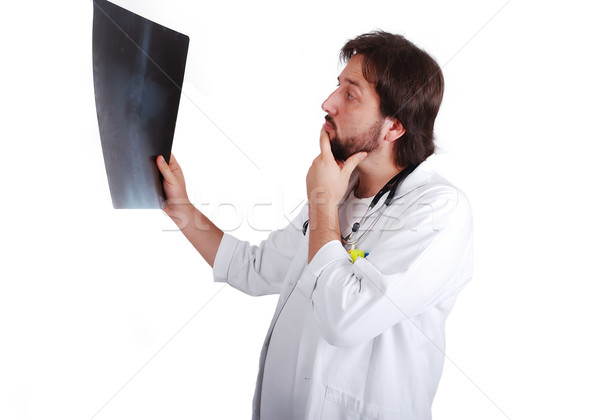 Young male doctor is looking on scan image Stock photo © zurijeta