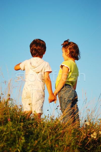 Romantic vision of two children standing together outdoor Stock photo © zurijeta