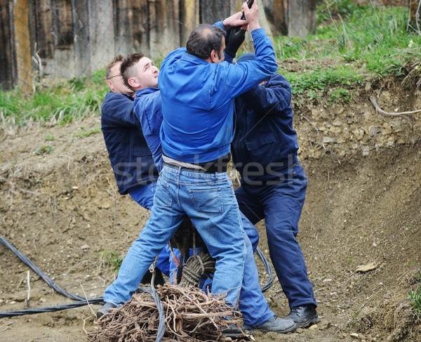 Csoport határozott munkatársak húz kötél épület Stock fotó © zurijeta