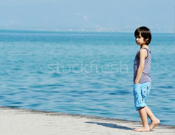 Kicsi fiú sétál dokk gyönyörű tenger Stock fotó © zurijeta