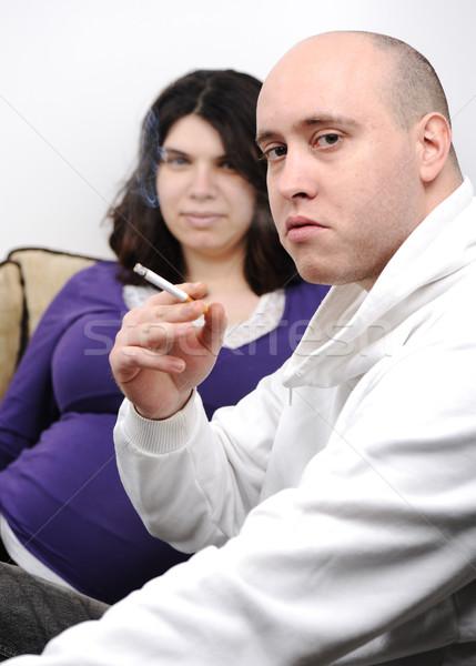 man smoking near pregnant woman Stock photo © zurijeta