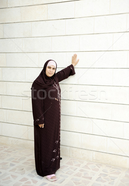 Muslim woman beside white wall, vertical photo good for your text or message Stock photo © zurijeta