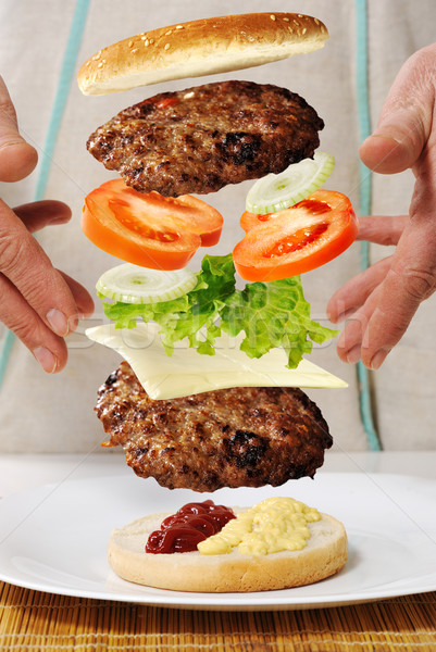 Levitating zero gravity burger in hands Stock photo © zurijeta