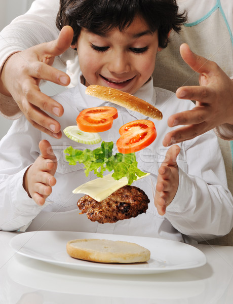 Mother and little boy with burger in hands Stock photo © zurijeta