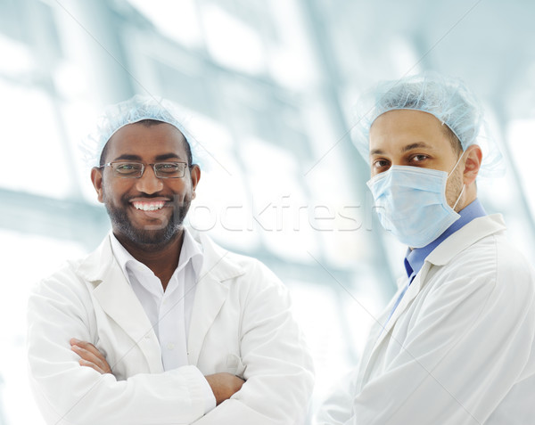 Working people with white uniforms in modern facility Stock photo © zurijeta