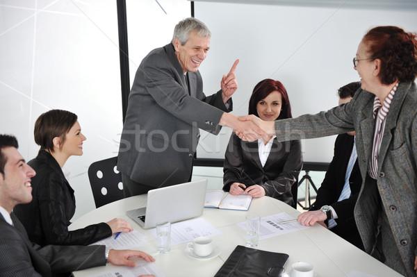 Kettő idős üzletemberek kézfogás megbeszélés nő Stock fotó © zurijeta