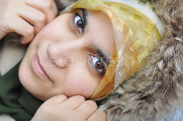 Asian arabic muslim woman with significant clothes, winter time Stock photo © zurijeta