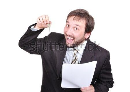 Young attractive businessman with keys and paper on white background Stock photo © zurijeta
