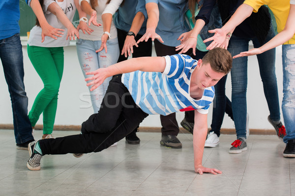 Young man dancing in classroom Stock photo © zurijeta