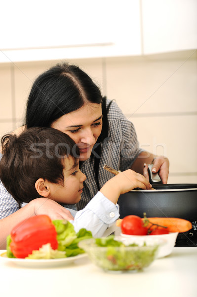 Happy mother and little son in the kitchen, happy time and togetherness Stock photo © zurijeta