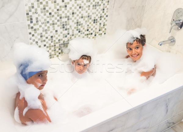 Kid playing in bathroom Stock photo © zurijeta