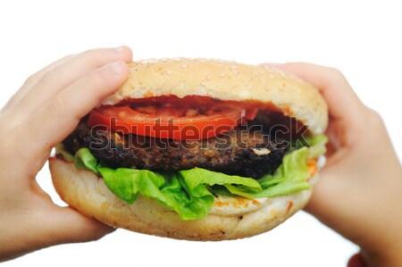 Hamburger fast food papier handen voedsel kaas Stockfoto © zurijeta
