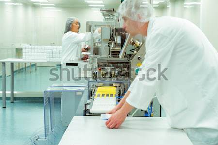 Workers in motion at modern drug factory  Stock photo © zurijeta