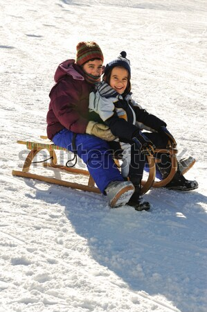 Brother and sister sledding down the hill, snow, winter, happiness and togetherness Stock photo © zurijeta
